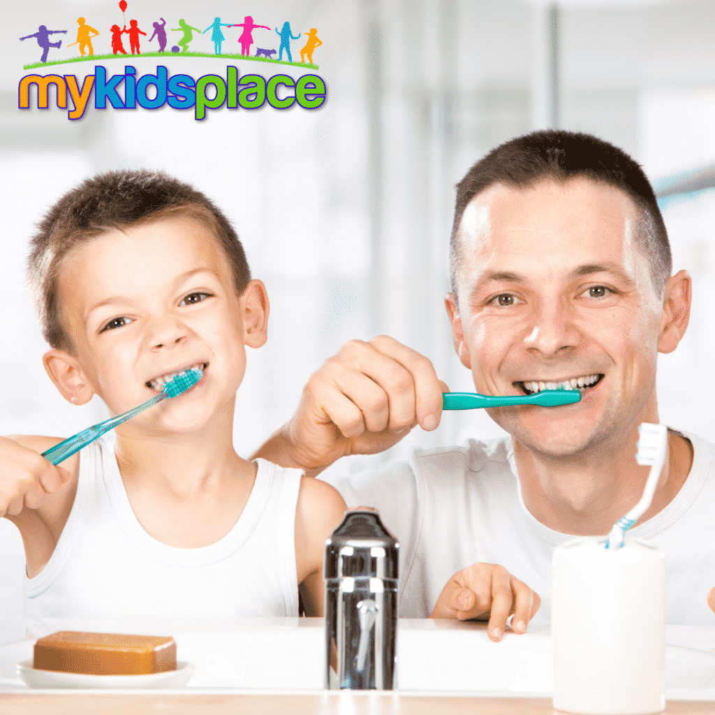 activities of daily living - A parent and child look in camera like a mirror while brushing their teeth
