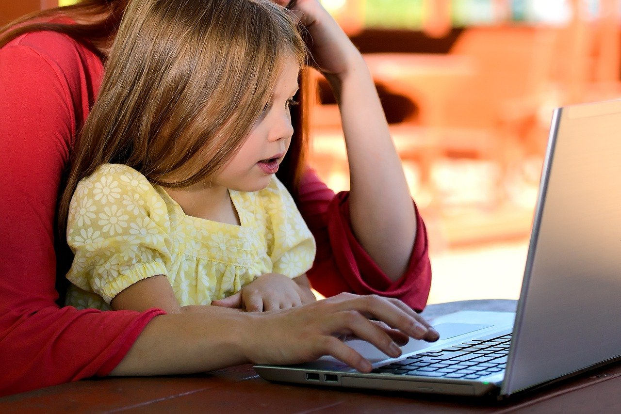 Child at computer with parent