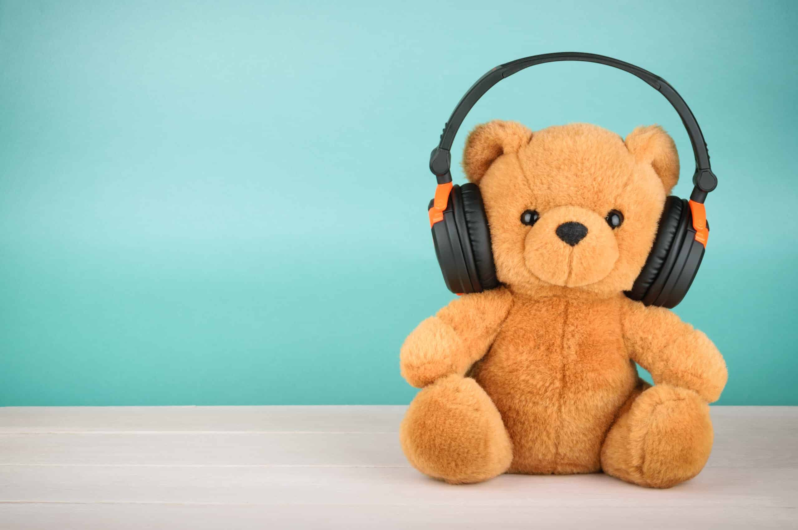 Teddy bear wearing noise-reducing headphones
